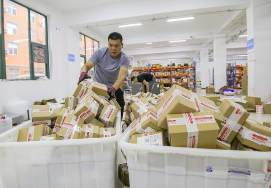 China's courier sector sees business volume jump over 50 pc